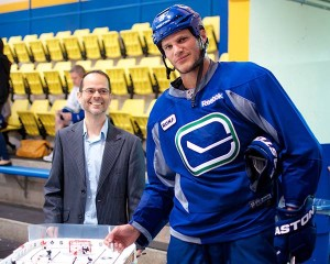 Kevin Bieksa is just one of the Vancouver Canucks who have signed part of the tournament grand prize. Register for $25 and you could walk away with a Stiga tournament-grade table hockey game! Photo by Jason Kurylo for Pucked in the Head.