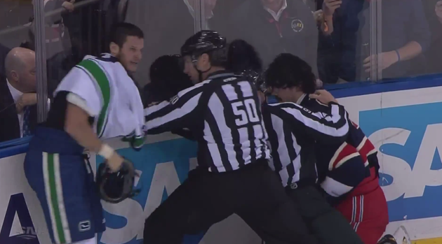 Kevin Bieksa fights Brian Boyle at the end of the Canucks/Rangers game.