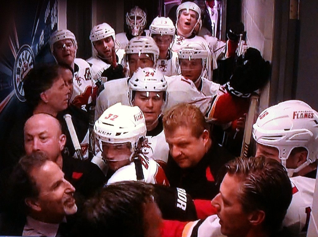John Tortorella tries to get into the Calgary Flames dressing room.