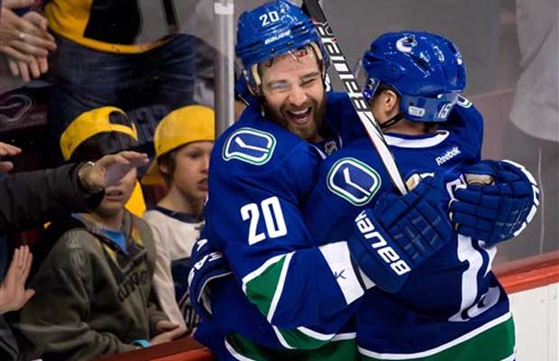 Chris Higgins of the Vancouver Canucks celebrates a goal he scored with teammate Derek Roy.