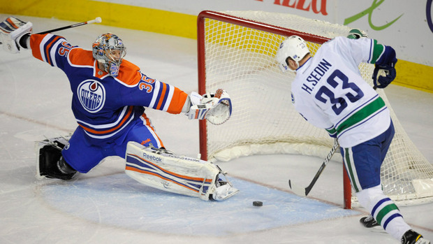 Henrik Sedin of the Vancouver Canucks scores against the Edmonton Oilers.