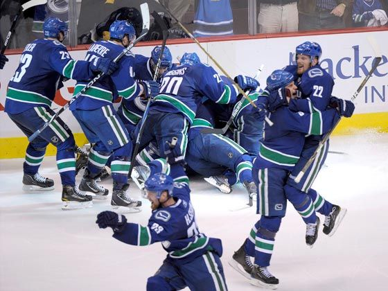 The Canucks celebrate their April 2011 playoff series win over the Blackhawks (Photo credit: Reuters)